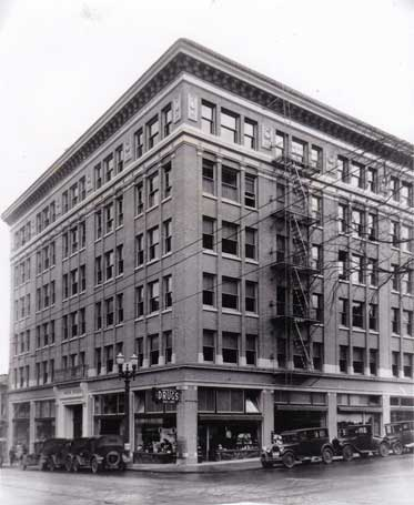 An historic black and white photo of the Mayer Building at SW 12th and Morrison.