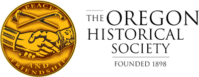 "The logo and seal of the Oregon Historical Society, founded in 1898. Two hands clasped between the words ""Peace and Friendship"""